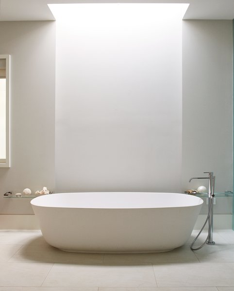 A freestanding Antonio Lupi tub defines the updated master bath, which also features an open-plan layout and a skylight by Velux.