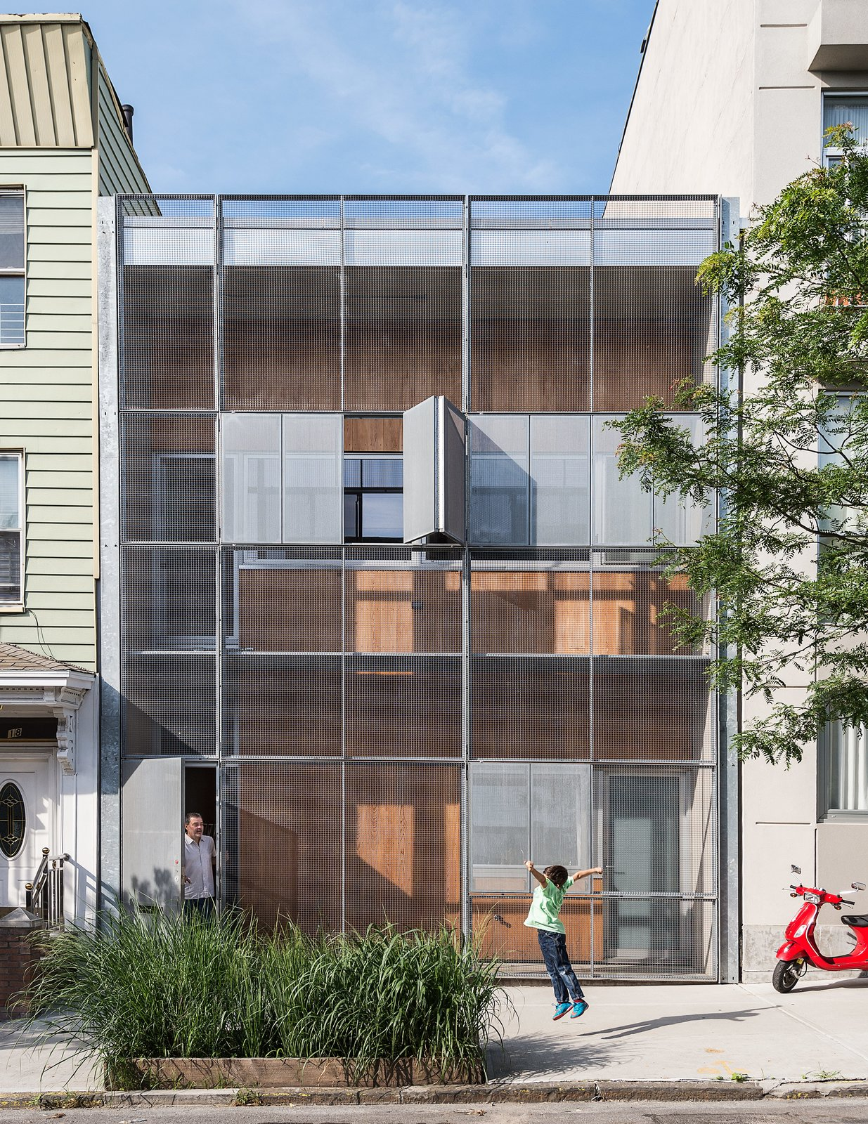The Baumann family residence in Gowanus, Brooklyn, is all geometry up front, with a rectilinear grid of steel and cypress comprising the structure's double facade. Tagged: Exterior, Metal Siding Material, House, and Wood Siding Material. Minimalist Facades We Love by Zachary Edelson