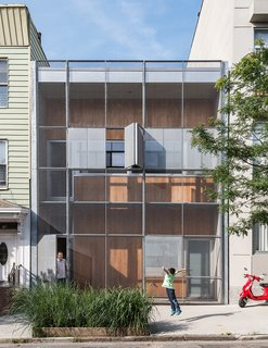A Rooftop Garden Completes This Urban Pastoral Home - Photo 1 of 11 - The Baumann family residence in Gowanus, Brooklyn, is all geometry up front, with a rectilinear grid of steel and cypress comprising the structure's double facade.