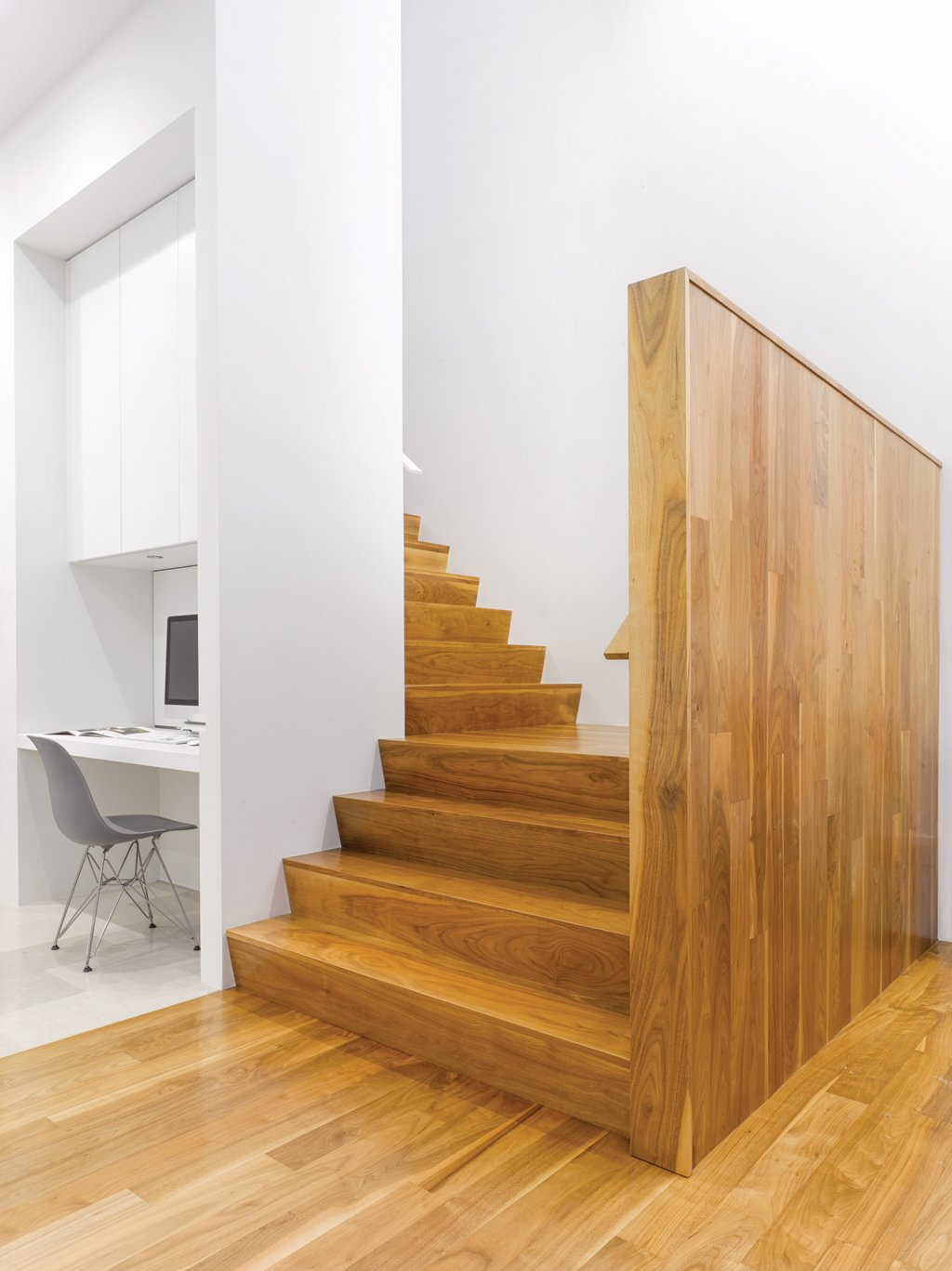 """""""We composed the house to have its highest, brightest space in the middle,"""" says Paul Raff. Warm wood stairs lead to the second floor, which houses guest bedrooms, bath, and a kitchenette for the family's frequent visitors. Tagged: Staircase and Wood Tread.  190+ Best Modern Staircase Ideas by Dwell from A Modern Toronto House Covered by a Contemporary Solar Screen"""