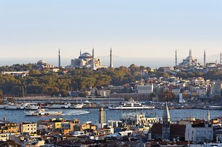 "Looking at Istanbul's old city from the trendy neighborhood of Beyoğlu, one can see the Hagia Sophia at left (rebuilt for the last time in the 6th century) and the 17th-century Sultanahmet (or ""Blue"") Mosque with its six minarets at right."