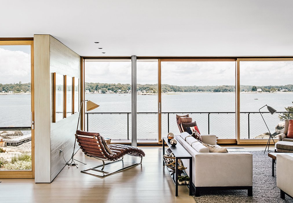 A Desiron sofa and a chaise longue from Restoration Hardware furnish the living room. Tagged: Living Room, Sofa, Chair, and Recliner.  Photo 4 of 13 in Seaside Views Make This Vacation Home a Relaxing Retreat