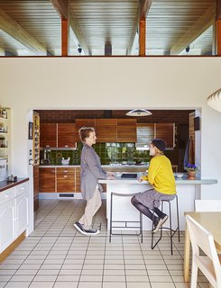 Quirky 1970s House in the English Countryside Showcases an Amazing Modern Furniture Collection - Photo 5 of 18 - Louise Jenkins, left, chats with her daughter, Freya, who sits on a powder-coated Slatted bar stool by Jasper Morrison manufactured in Lancashire.
