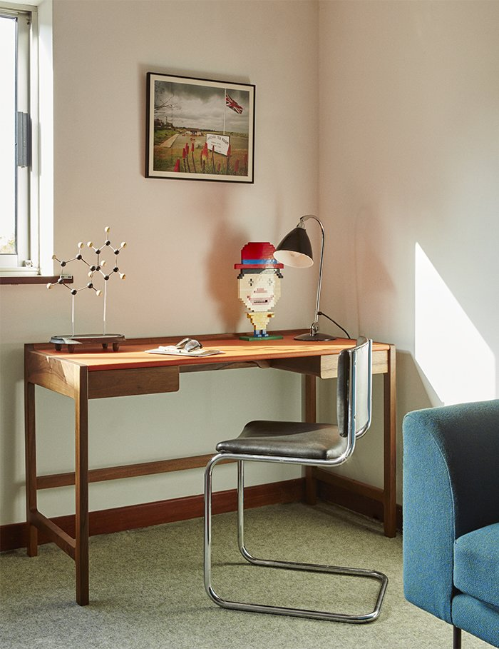 A 2009 Cedric desk by Kay + Stemmer occupies the study. Tagged: Office, Desk, and Lamps.  Photo 10 of 18 in Quirky 1970s House in the English Countryside Showcases an Amazing Modern Furniture Collection