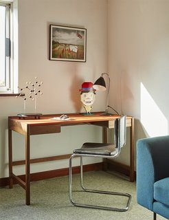 Quirky 1970s House in the English Countryside Showcases an Amazing Modern Furniture Collection - Photo 10 of 18 - A 2009 Cedric desk by Kay + Stemmer occupies the study.
