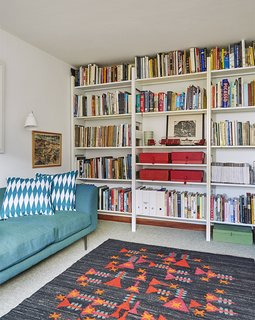 Quirky 1970s House in the English Countryside Showcases an Amazing Modern Furniture Collection - Photo 11 of 18 - A pressed-steel Parallel shelving system by Terence Woodgate holds books and mementos.