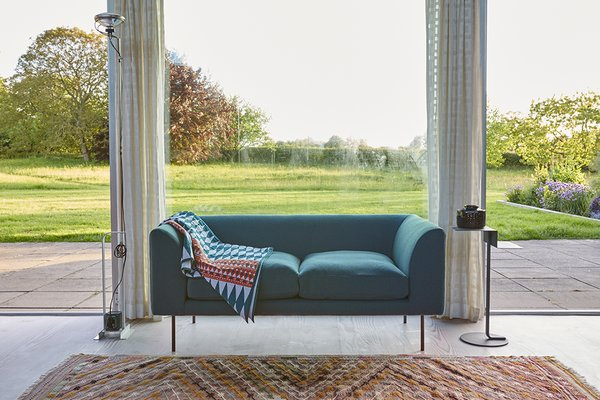 The loveseat is by Terence Woodgate.