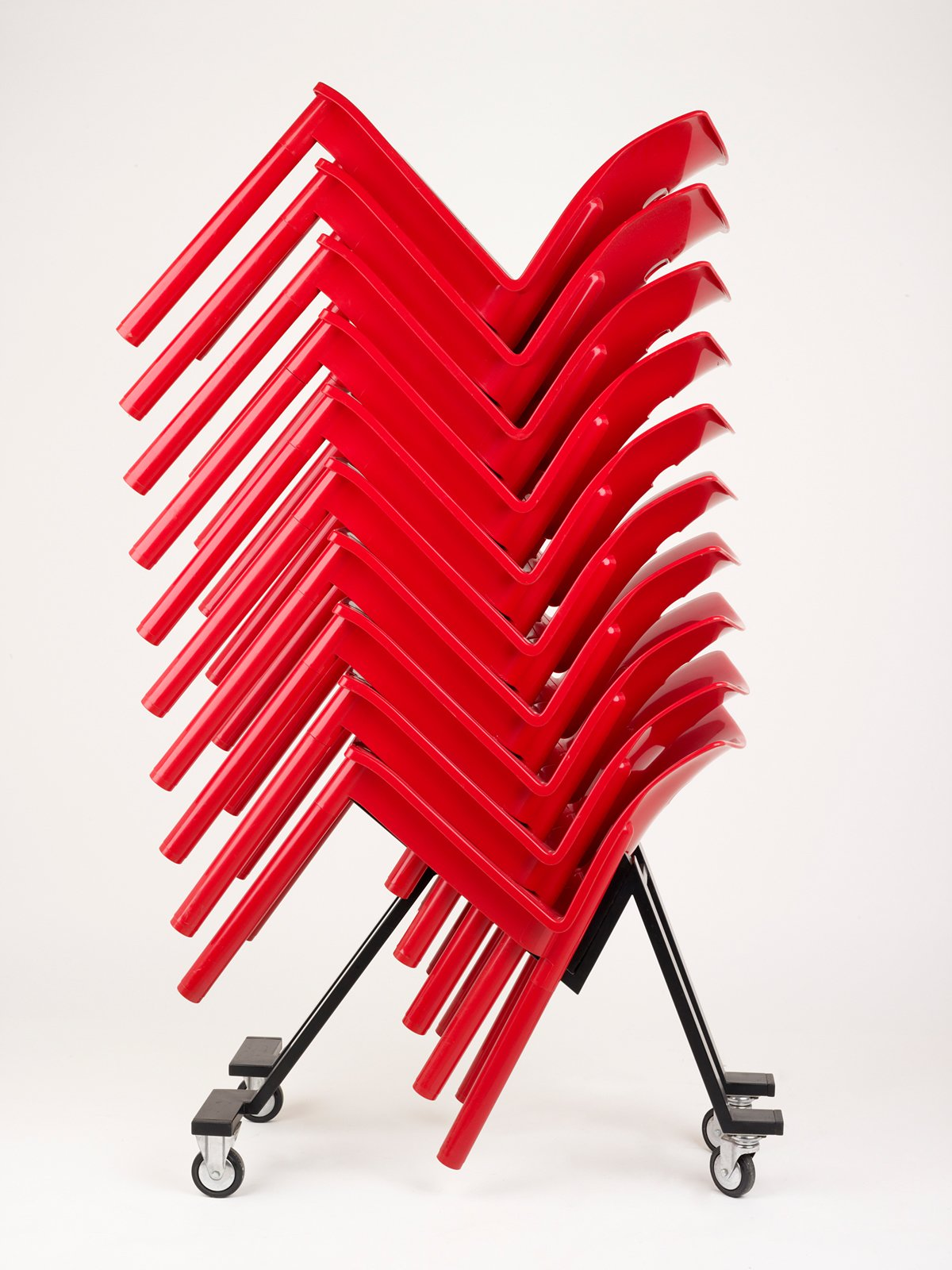 Stacking chair by Anna Castelli-Ferrieri for Kartell.  Design Museum London's Extraordinary Stories about Ordinary Things by Rebecca L. Weber