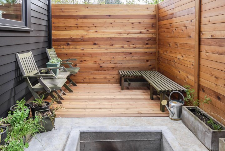 The gap between the house and the fence creates a small patio with space for raised bed vegetable gardening.