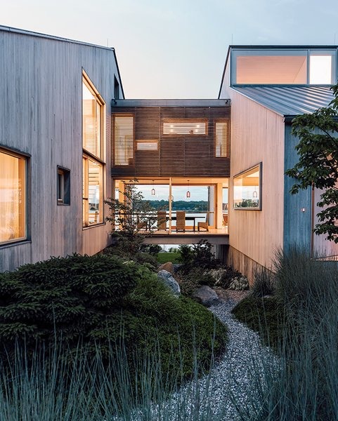Gray Organschi took down a worn-out 1970s summer home and reinvented it as a serene pair of bleached cedar volumes connected by a glass bridge.  Photo 2 of 13 in Seaside Views Make This Vacation Home a Relaxing Retreat