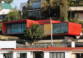 10 Homes With Distinctive Facades - Photo 8 of 10 - One of Rojkind's first commissions, in 2001, was a rooftop apartment for a ballerina above her father's 1960s-era house in the Mexico City suburb of Tecamachalco. Dissatisfied with the look of the Cor-Ten steel exterior, Rojkind hired auto-body workers to finish it with a coat of red automotive paint.