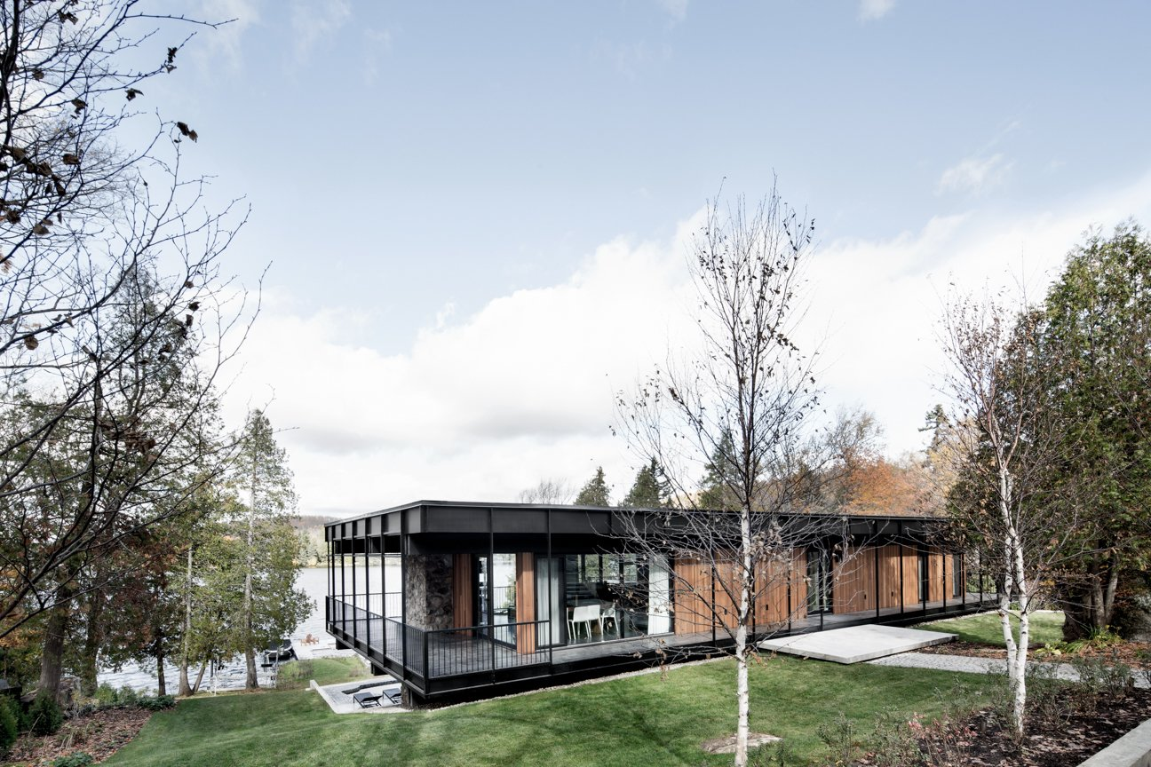 Carle revived the home's exterior by recladding it in fresh cedar planks, local stone, and black anodized aluminum. He also replaced the original windows — all damaged — and changed the sizes of some to respond better to the outdoors.