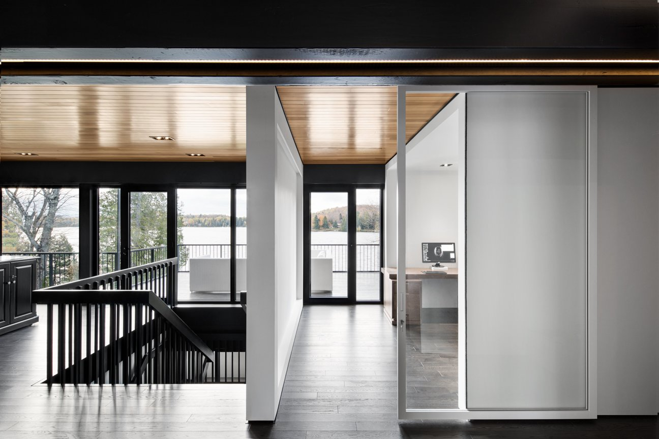 """In addition to adjusting the windows, Carle dislocated all wall partitions from the main structure of the house to create a more open feel. """"This way, we're going back to the mythical plan libre dogma of those days, as a wink to our ancestors,"""" the French-Canadian architect jokes.  The Phoenix by Laura C. Mallonee"""