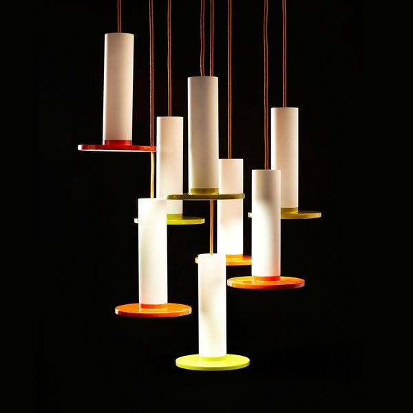 """The Cielo Lamp from Pablo is defined by its use of simple, circular shapes. The lamp is comprised of a cylinder that yields to a flat circular LED panel. The Spanish word for """"heaven"""" and """"sky,"""" Cielo is a pendant lamp, and can be hung from a variety of ceilings, whether the light is used in an entryway or to illuminate a dining room table. This light balances color with a white stem—helping to balance the boldness of the color.  Also available in black."""