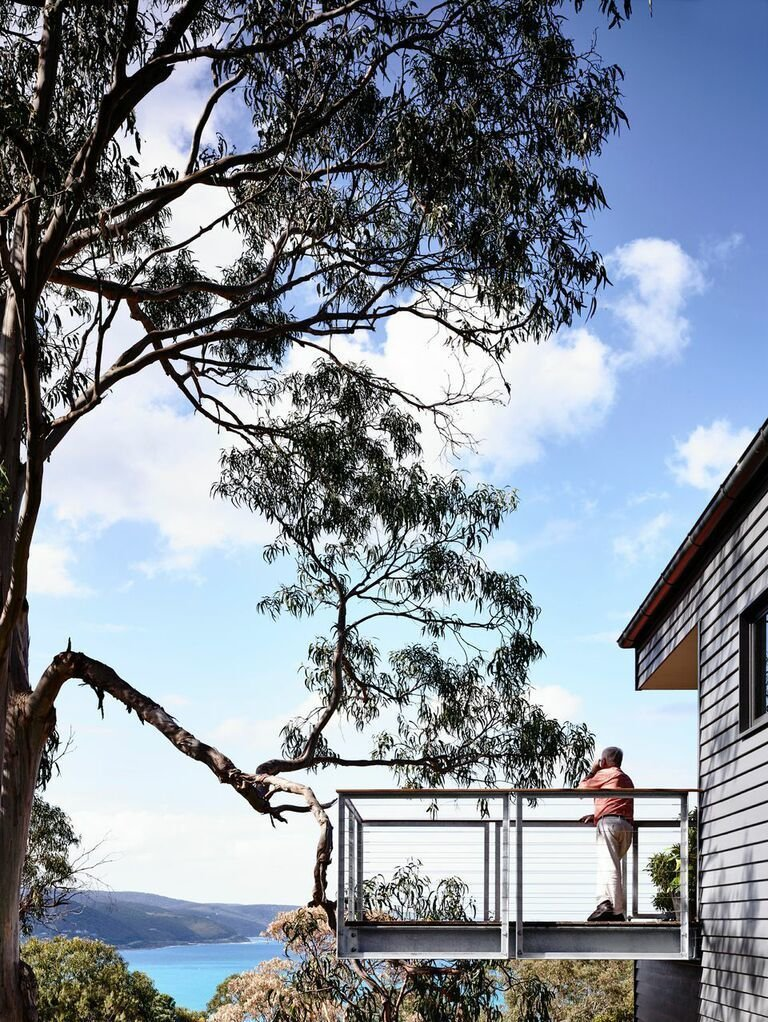 "The cantilevered deck juts out from the home. ""You really feel like you're floating,"" Harnkess says.  Photo 8 of 8 in A Breezy Modern Beach House Sits Among the Trees in Australia"
