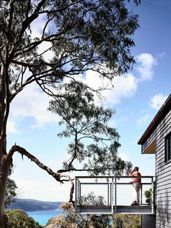 """A Breezy Modern Beach House Sits Among the Trees in Australia - Photo 8 of 8 - The cantilevered deck juts out from the home. """"You really feel like you're floating,"""" Harnkess says."""
