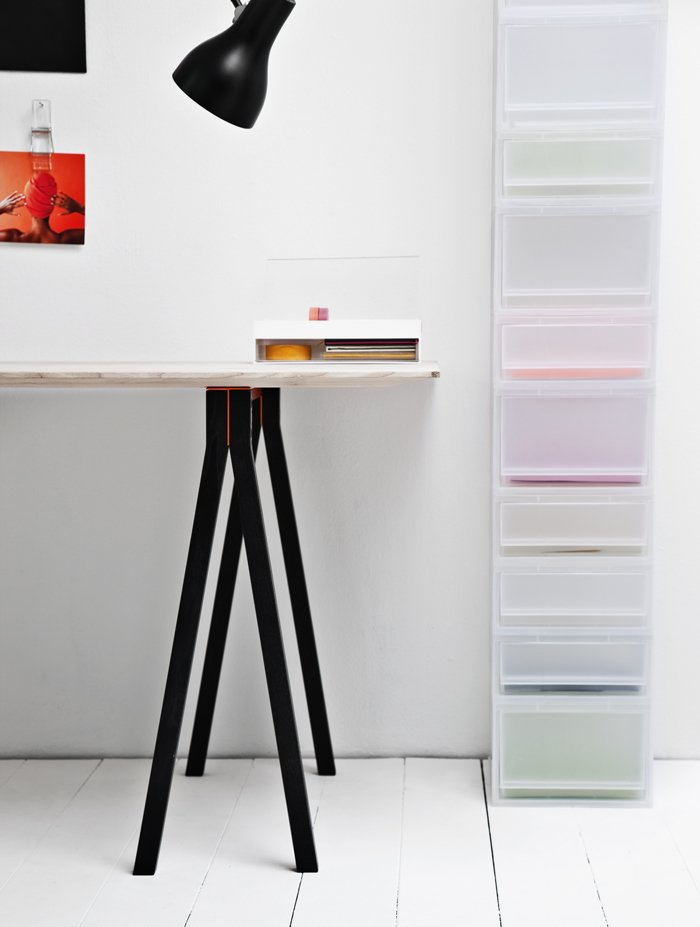 4-Dots trestle table in natural ash wood with black stained split legs. The dots on top come in white or orange. Shown with Milky Boxes stacked at right.  Storage by Dwell from Mod Storage Accessories from Nomess Copenhagen