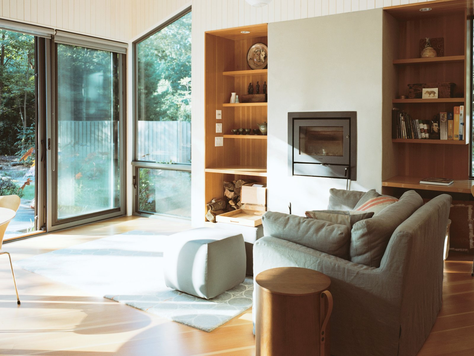 For the floor and built-ins, the architects opted for Douglas fir. The recessed wood-burning stove is a Morsø 5660.