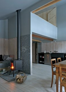 Editor's Picks: 7 Inspiring Small Spaces - Photo 5 of 7 - In Switzerland, designer Jonathan Tuckey lent his singular, sophisticated vision to his family's bifurcated mountain chalet. Moody interior finishes enrich an unusual architectural program, resulting in a winsome space that's both cozy and modern.