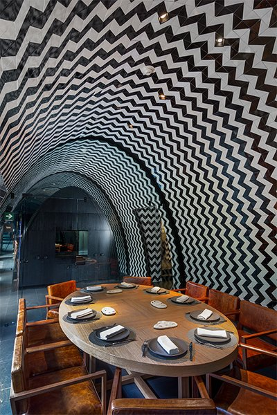The chef's table offers an intimate area to enjoy the cuisine of rising culinary star Josefina López Méndez against a dramatic backdrop of zigzagging black-and-white tiles.
