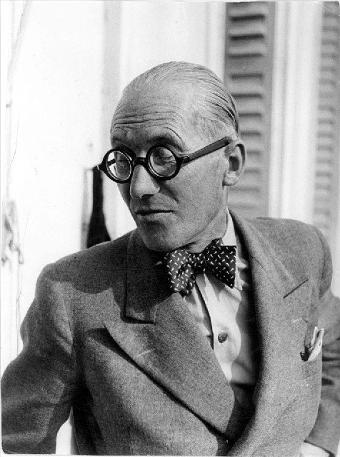 Architects weren't the only professionals to favor bow ties—surgeons, printers, and anyone else who didn't need a necktie flapping around as he worked wore them. But Corbu's bow gives his peak lapels and pocket square a bit of elan you rarely found on country doctors.  Photo 2 of 7 in Le Corbusier: The Most Stylish Architect in History from Most Stylish Architect in History: Le Corbusier