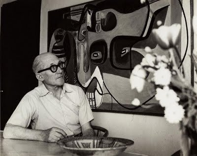 Casual duds here, and perfect proof that one bold accessory (can't get over those glasses) elevates a pretty basic look.  Photo 6 of 7 in Le Corbusier: The Most Stylish Architect in History
