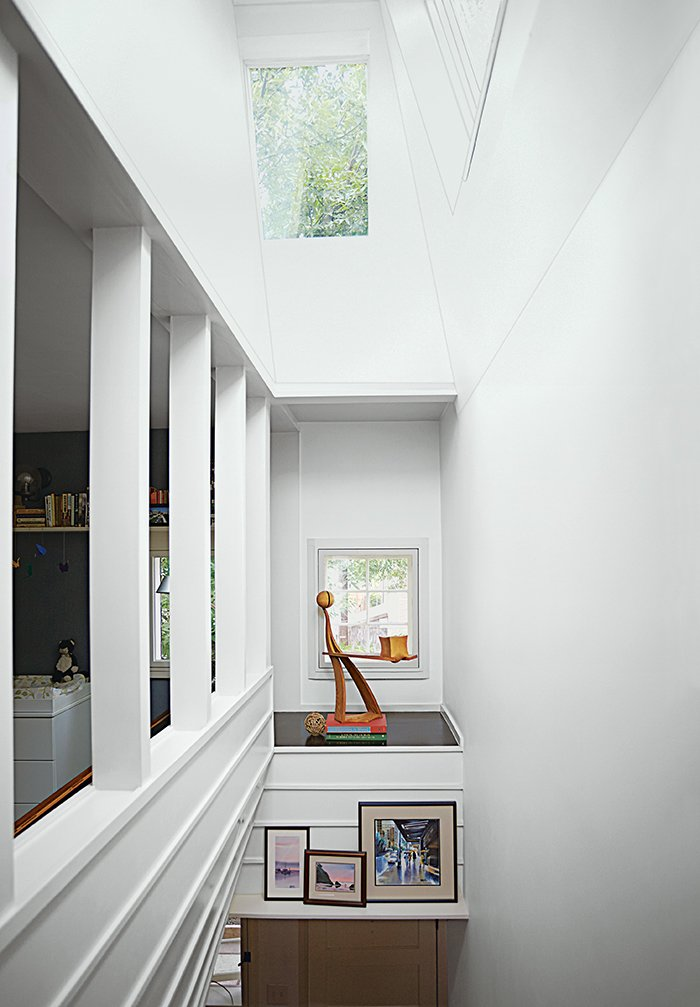 An alcove in the stairwell displays a white ash sculpture by Bradley.  Small Spaces by Restoration Philly from Run-Down Row House in Boston Becomes a Quiet Urban Escape with Two Green Roofs