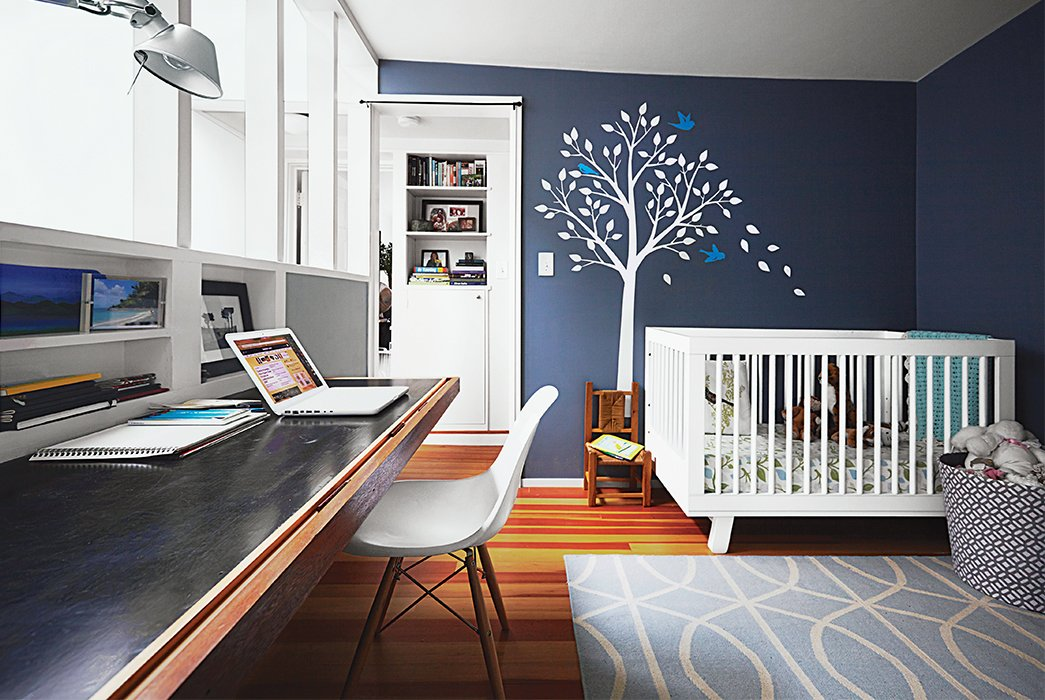 The office, which is also Lily's room, features a Babyletto crib and a Smileywalls wall decal applied atop Normandy paint from Benjamin Moore. Tagged: Kids Room, Bedroom, Bed, and Desk.  Photo 17 of 20 in 20 Cool Cribs for the Modern Baby from Run-Down Row House in Boston Becomes a Quiet Urban Escape with Two Green Roofs