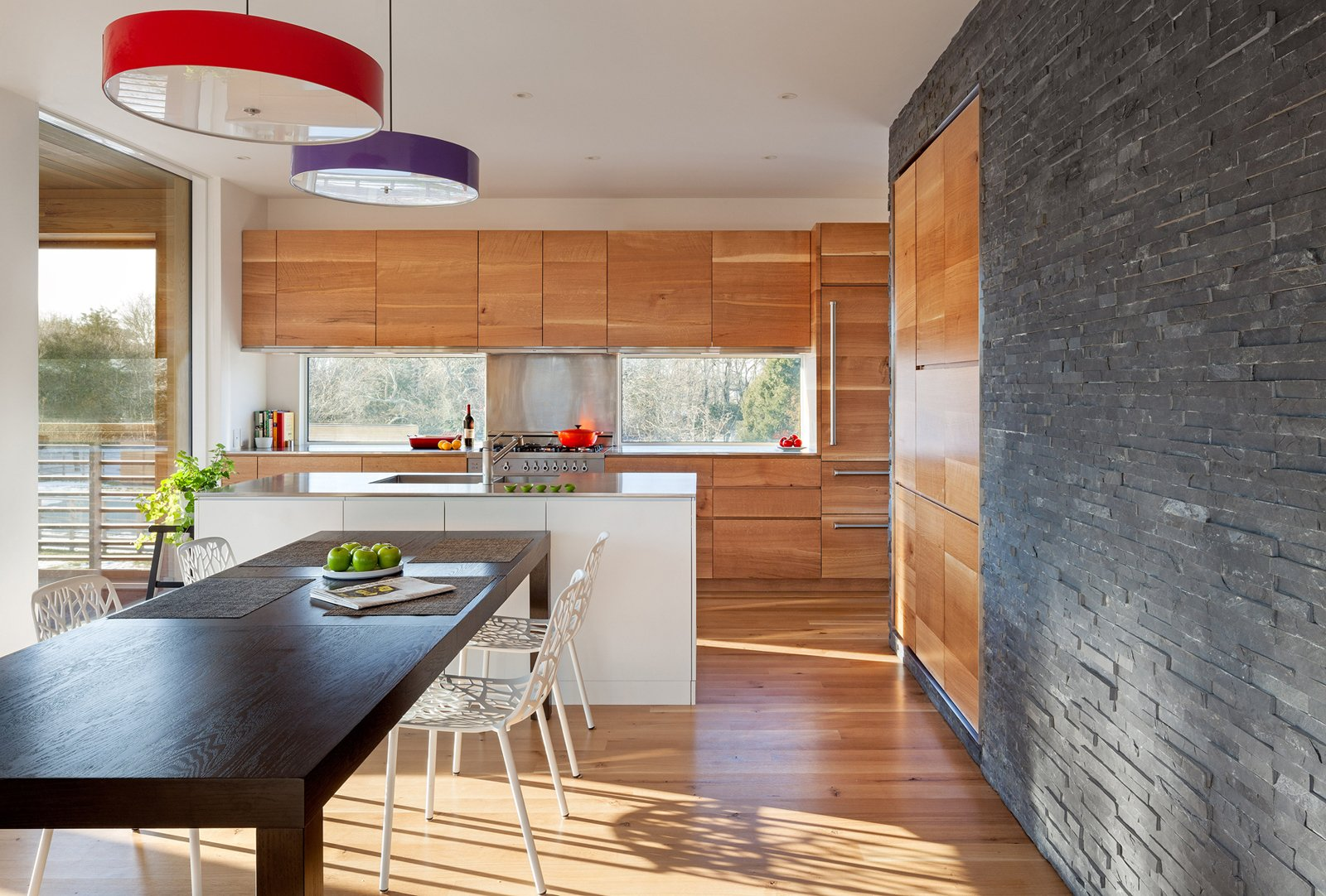 Tagged: Kitchen, Wood Cabinet, Medium Hardwood Floor, and Pendant Lighting.  Watch Hill by Diana Budds