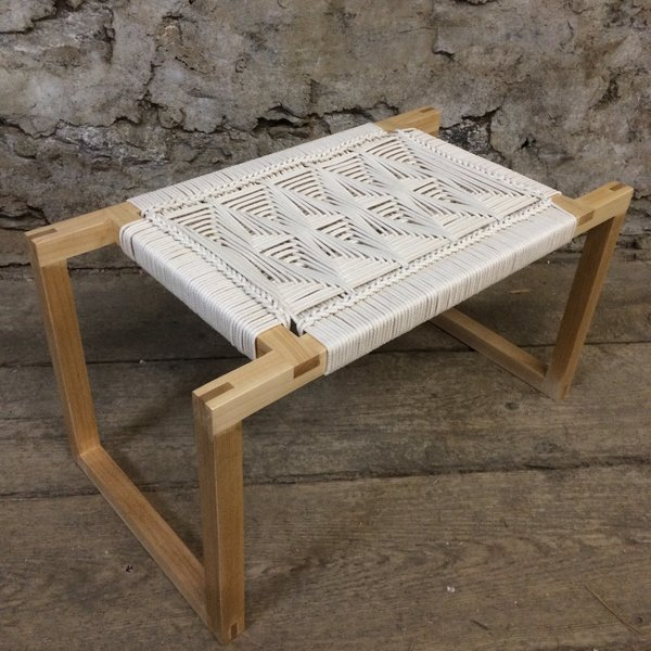 Peg Woodworking's charming furniture begins with artfully made Shaker-simple wood frames created by designer Kate Casey, which she painstakingly embellishes with cotton-cord patterns that reference the traditions of Danish cord-weaving and '70s-style macrame.
