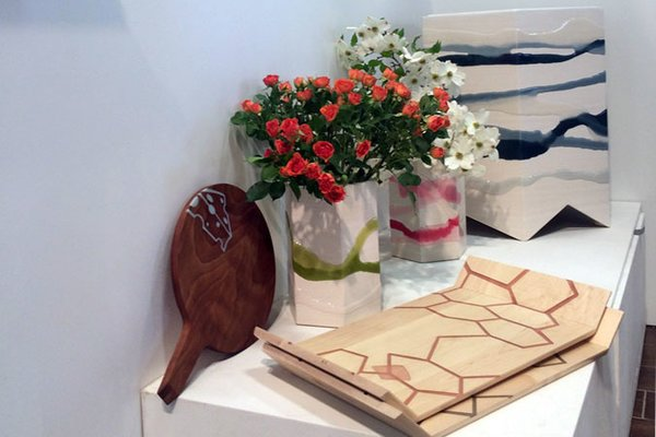 """Molly FitzSimons and Christopher Moore of Noble Goods have recently expanded their line from resin-inlaid hardwood pieces to new """"folded"""" tables and planters, each made with a single seam and covered in washes of poured resin."""