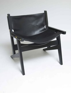 For a sleeker look, opt for the Peninsula chair in black. The whole chair is kept together by eight brass screws.