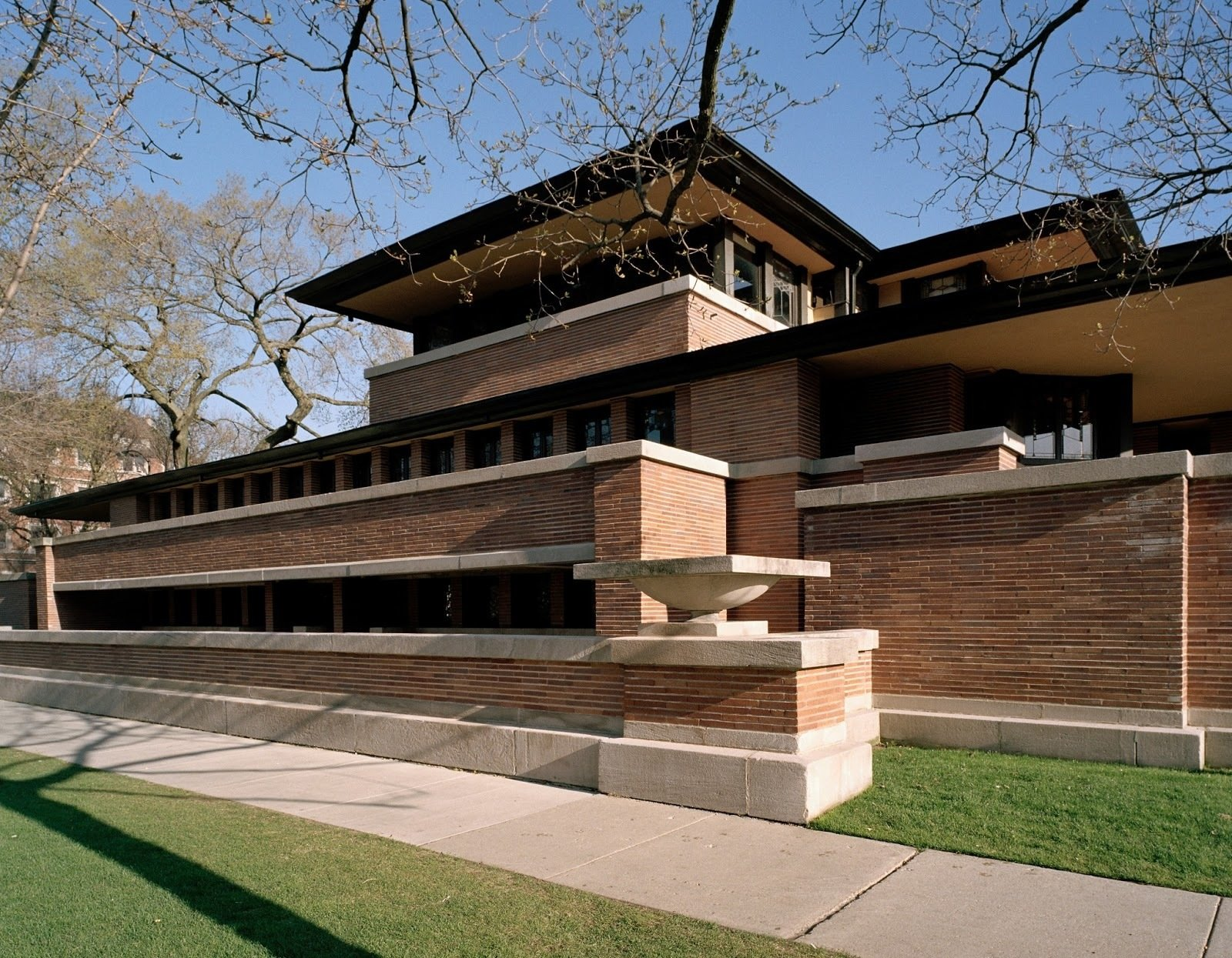 "Robie House, Chicago, Illinois (1910)""Early in life I had to choose between honest arrogance and hypocritical humility. I chose honest arrogance."" It should come as no surprise who uttered those words—the architect of the famed Robie House, Frank Lloyd Wright. The residence, with its tight recessed entry leading to dramatic light-filled openness, seamless space unencumbered by needless partitions, continuous bands of windows, its horizontal, low-slung form, and overhanging eaves, is what the architect called ""a cornerstone of American architecture.""  Tiny Homes by Scott Saunders from Buildings That Changed America"