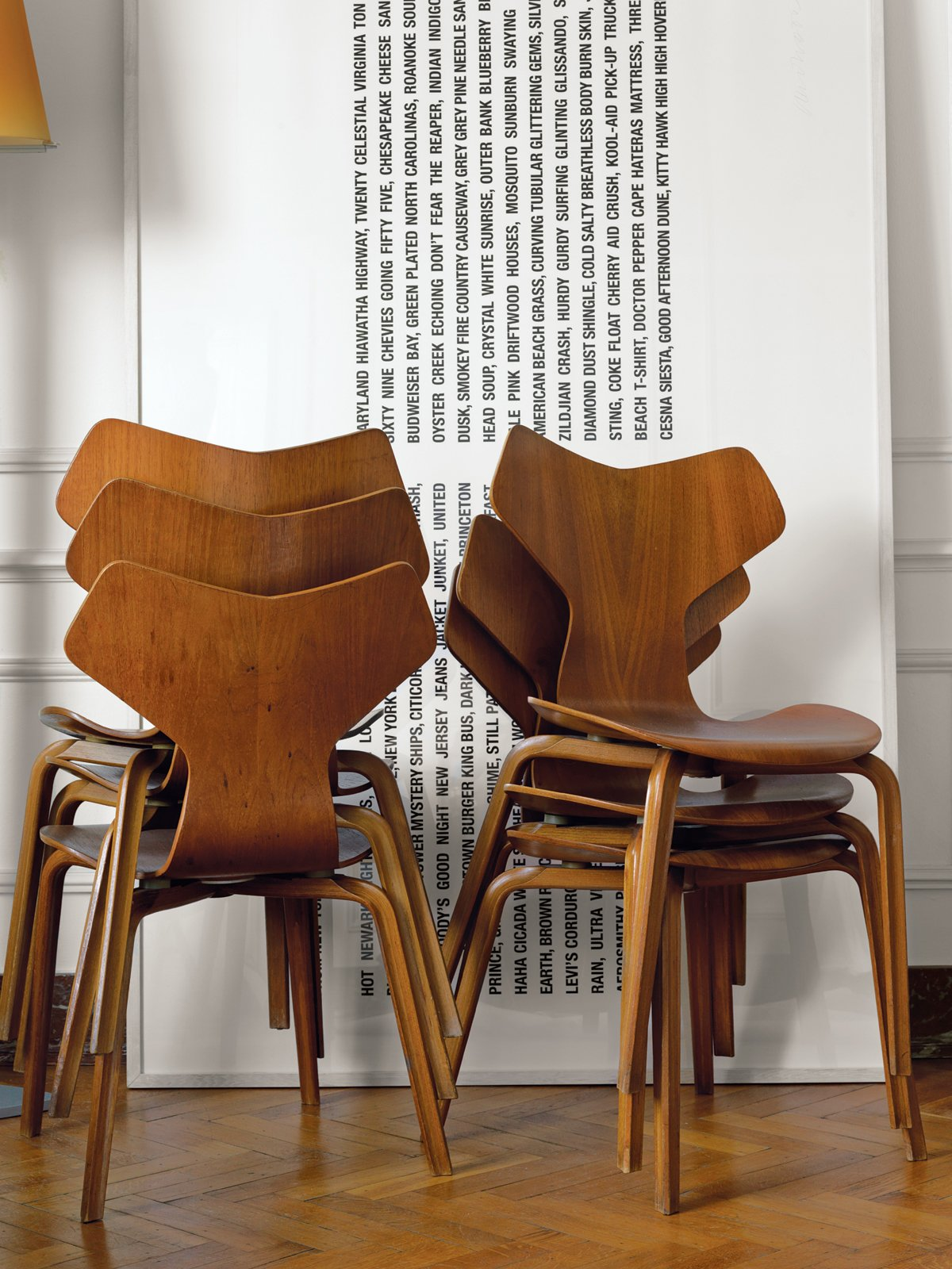 A stack of 1955 Grand Prix chairs by Arne Jacobsen rests besides a minimal art piece. Tagged: Living Room and Chair.  100+ Best Modern Seating Designs by Dwell from A Neoclassical Gallery Home in Belgium