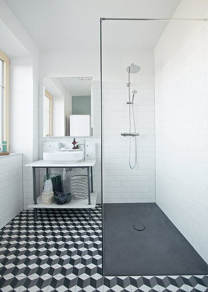 New cement tile from Mosaic del Sur, Hansgrohe fixtures, a shower plate from Bette, and Farrow & Ball's Chappell Green paint round out the room.