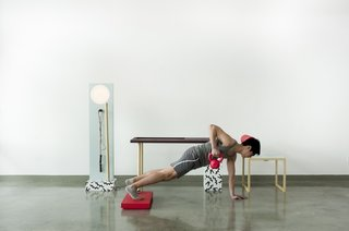 Workspace Workout Furniture by Darryl Agawin - Photo 3 of 4 - Easily remove the red laptop rester from the desk to create some height while lifting. Photo by: Mark Stokoe