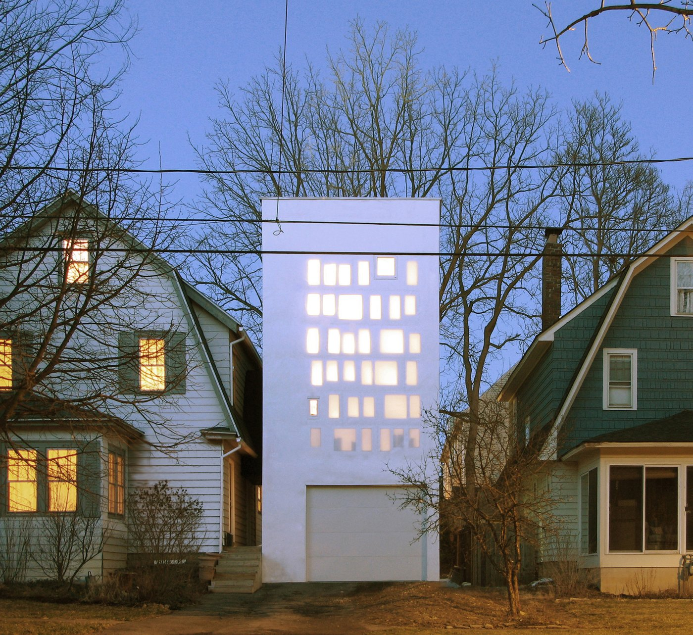 The façade is wrapped in 3-millimeter-thick silicon impregnated fiberglass fabric. This produces its unique, translucent glow while also ensuring that light is transmitted to the interior and the owners' privacy is protected. Curb Appeal: 7 Stunning Facades That Must Look Great on Google Maps by William Harrison