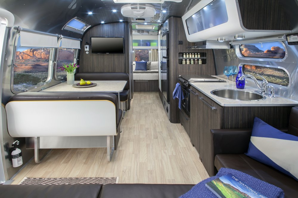 The 28-foot Airstream International Series features interiors by Christopher C. Deam; it sleeps up to six people and includes camping chairs, a gas grill, kitchen amenities, and bike rack.  Photo 8 of 8 in Airstream: Re-designing an American icon from Westward, Ho! With Airstream 2 Go