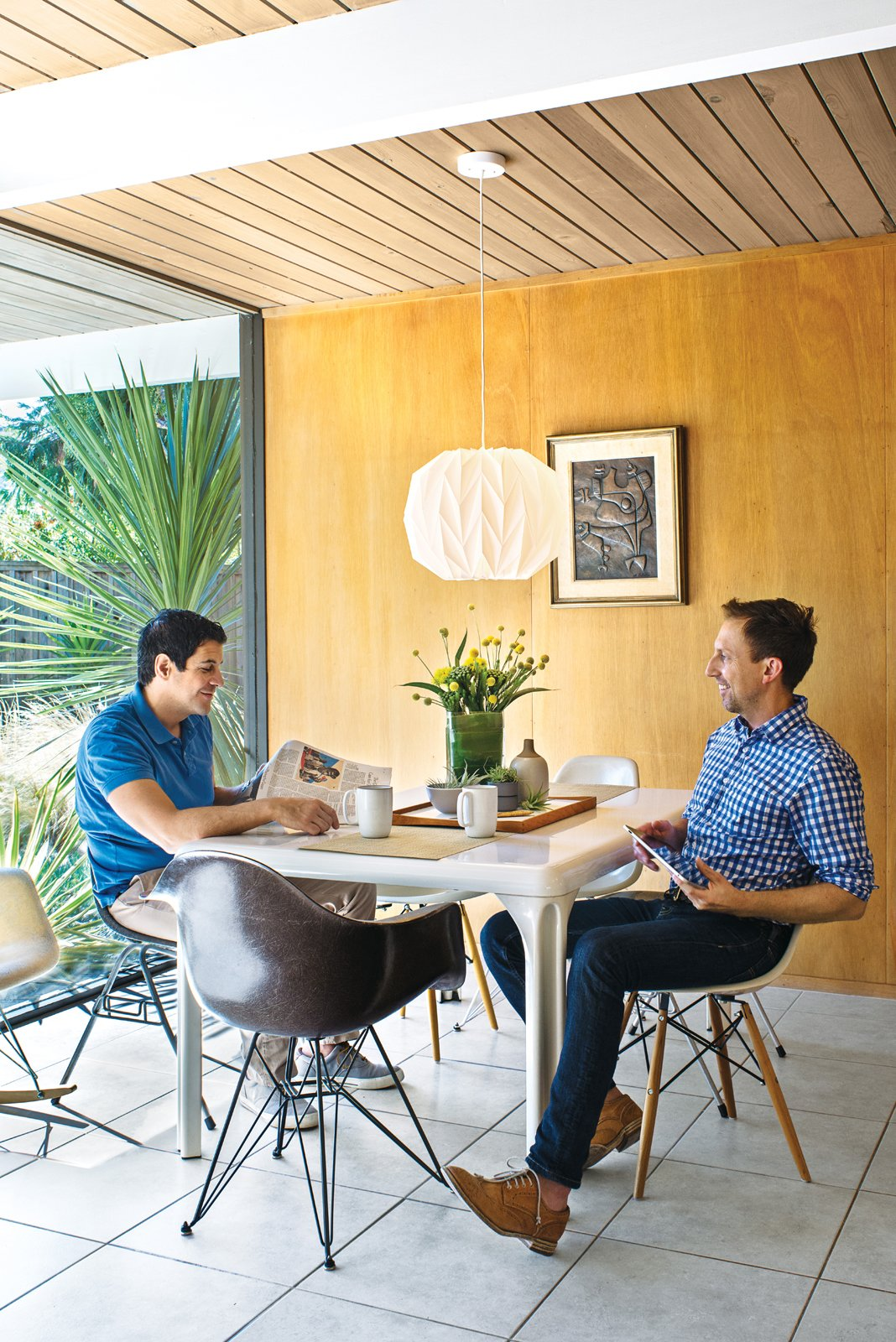The couple's vintage Stadio dining table is by Vico Magistretti for Artemide; the Eames chairs came from an old school in Palm Springs.  Midcentury Homes by Dwell from Modern Furniture Fit for a Classic Eichler