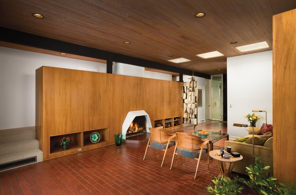 The living room features two side chairs and an end table by Edward Wormley for Dunbar and a bronze screen designed by Harold Balazs.