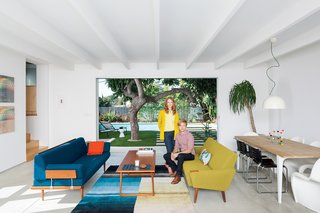 The Modern Renovated Home of Glee Star Jayma Mays - Photo 2 of 13 - Glee star Jayma Mays and actor Adam Campbell in the living room of their Los Angeles home.