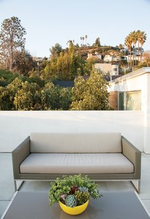 The Modern Renovated Home of Glee Star Jayma Mays - Photo 5 of 13 - Jacobs transformed the roof into a series of decks, this deck features Crate & Barrel's Dune sofa and coffee table.