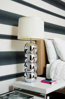The Modern Renovated Home of Glee Star Jayma Mays - Photo 1 of 13 - Mays chose Graham & Brown's Verve Stripe wallpaper for the downstairs bedroom. The chrome lamp is vintage.