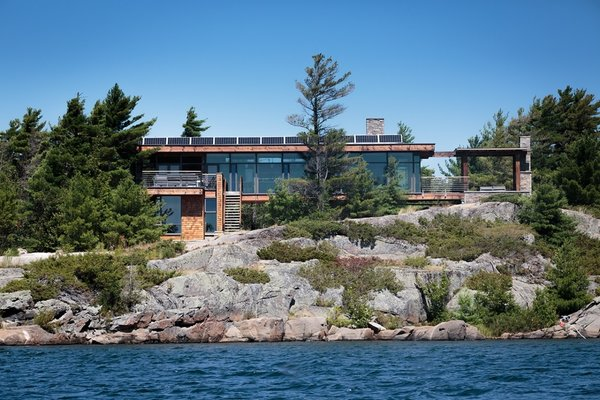 Though it is spacious and modern, Gane's cottage functions entirely off-the-grid. Sewage is treated on-site, water is filtered from the lake and cleansed with ultraviolet light, and an impressive solar array provides energy with battery storage. Photo 5 of Monument Channel Cottage modern home