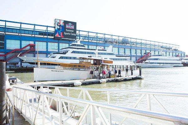 The sea vessel Manhattan resembles a 1920's commuter yacht.