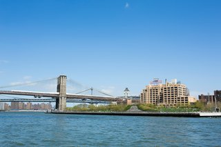 Around Manhattan Architectural Boat Tours by AIA New York - Photo 3 of 13 - The Brooklyn Bridge Park's greenery encroaches on the East River.