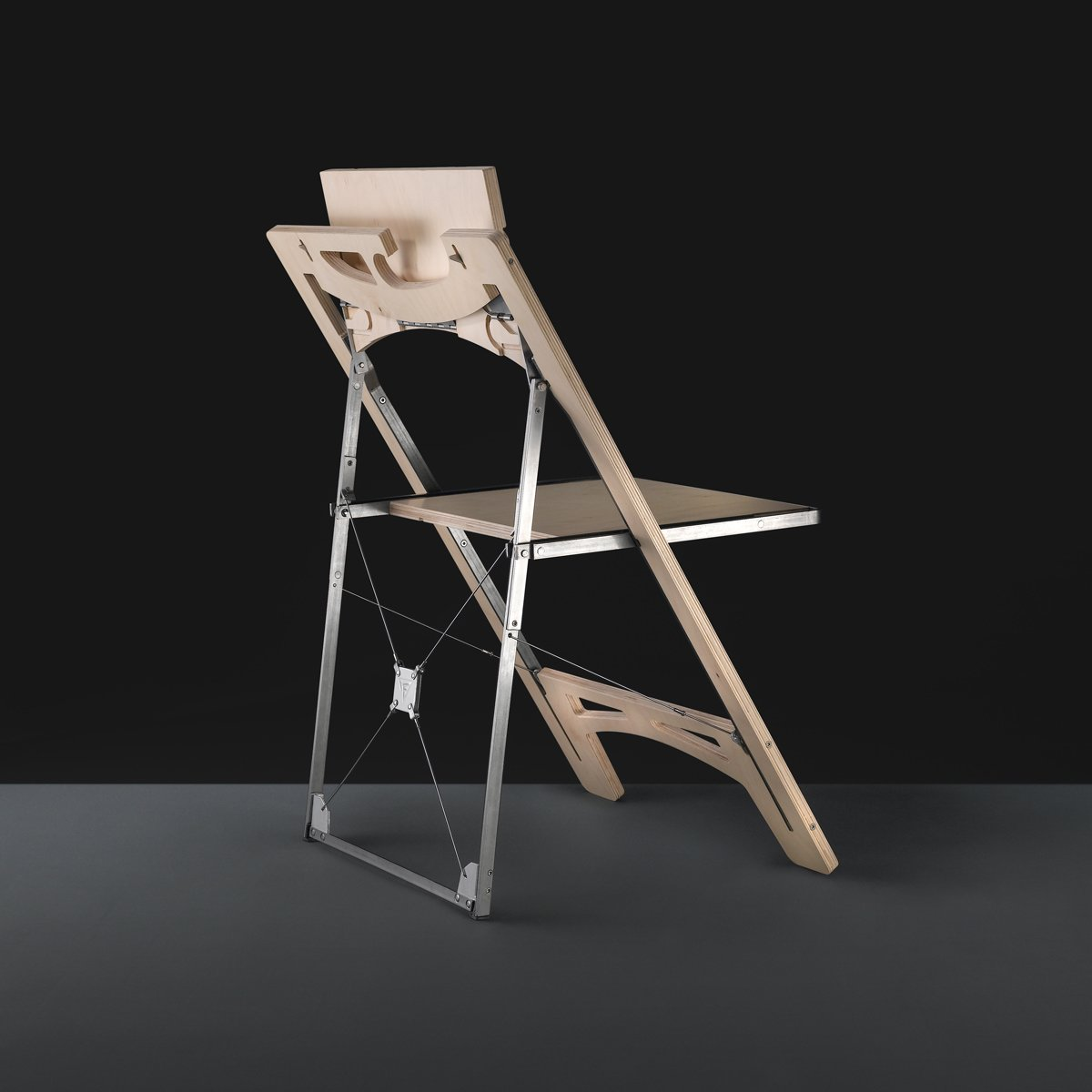 The Tilt chair by Folditure.  Small Spaces by Monica Suarez from More Hideaway Furniture from Folditure
