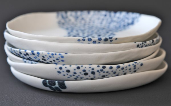 Growing up in California, Maria Moyer was inspired by nature from an early age. The ocean, in particular, is a constant source of inspiration.<br><br>Discs, blue wash on unglazed white porcelain, available at March in San Francisco.