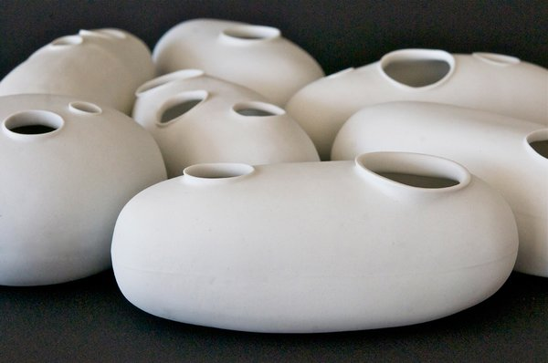 """The process of making is at the heart of Moyer's work, and evidence of human touch, like a visible fingerprint or two, often remains on the work after firing. """"It's the perfect blend of intellectual-physical pursuits—the idea and the knowledge of how to do something and then, finally, the actual physical ability of being able to manifest it,"""" she says. """"The learning never stops and the results vary. Some things work, others just don't.""""<br><br>Orbs and vacuoles, unglazed porcelain, available at March in San Francisco."""