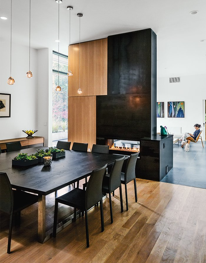 Large family gatherings are common so the dining table by Moon Custom Millwork comfortably seats 12; it's made from wood that resident Sam Chung salvaged himself.